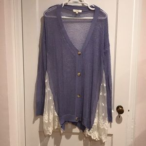 Loose fit purple cardigan with lace sides.
